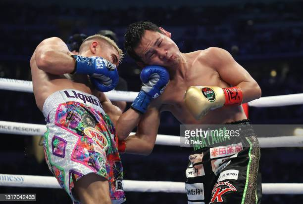 Elwin Soto punches Katsunari Takayama, during their fight for Soto's WBO junior flyweight title at AT&T Stadium on May 08, 2021 in Arlington, Texas.