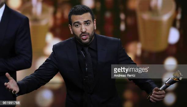 Elyas M'Barek accepts the award 'Biggest Movie Audience' for the film 'Fack ju Goehte' on stage during the Lola German Film Award show at Messe...