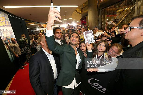 Elyas M'Barek and fans during the world premiere of 'Fack ju Goehte 2' at Mathaeser Kino on September 7 2015 in Munich Germany
