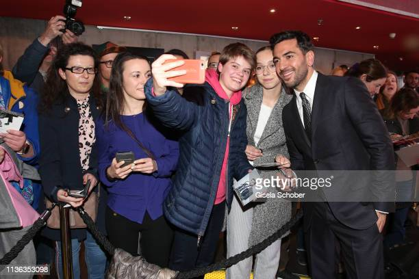Elyas M'Barek and fans take a selfie during the Der Fall Collini premiere at Mathaeser Filmpalast on April 11 2019 in Munich Germany