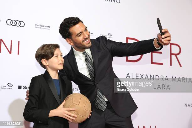 Elyas M'Barek and Leonardo Orsolini take a selfie during the Der Fall Collini premiere at Mathaeser Filmpalast on April 11 2019 in Munich Germany