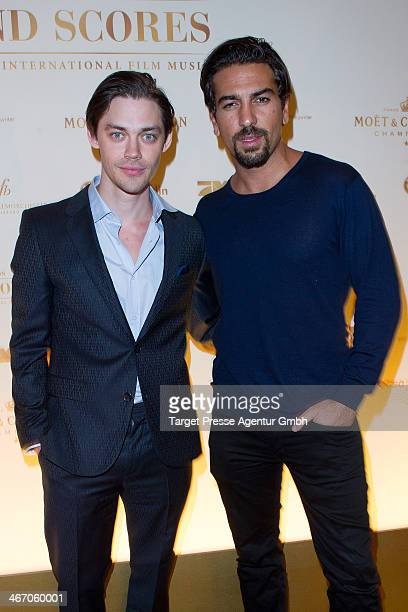 Elyas M'Barek and Tom Payne attend the Moet Chandon Grand Scores at Kaufhaus Jandorf on February 5 2014 in Berlin Germany