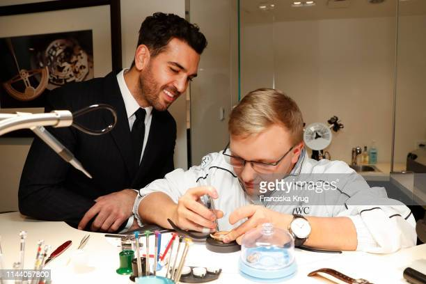 Elyas M'Barek and watchmaker Ralph Wechtl attend the IWC Schaffhausen Pilots Watches Launch Event Boutique in Munich on May 16 2019 in Munich Germany