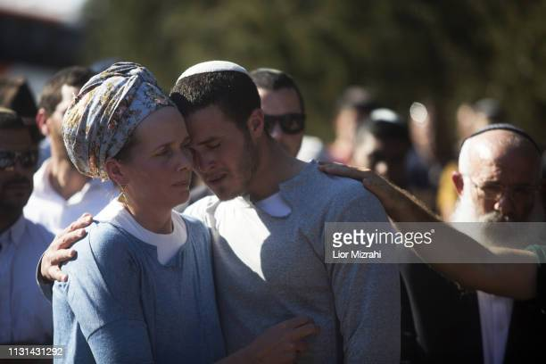 Elyashiv and Tamar mourn during the funeral of Rabbi Achad Ettinger on March 18 2019 in Eli settlement West Bank Rabbi Achad Ettinger was shot on 17...