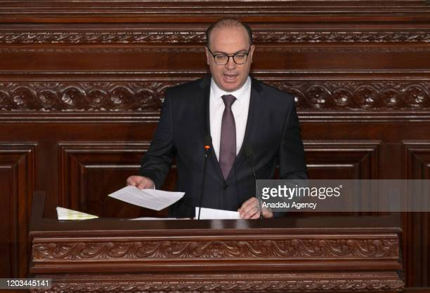 Elyes Fakhfakh, tasked to form the new government, speaks during the session held for the vote of confidence at Tunisian parliament in Tunis, Tunisia...