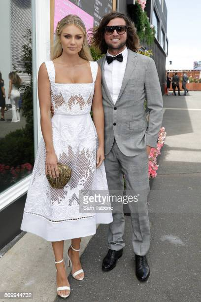 Elyse Knowles and Josh Barker pose on Derby Day at Flemington Racecourse on November 4 2017 in Melbourne Australia