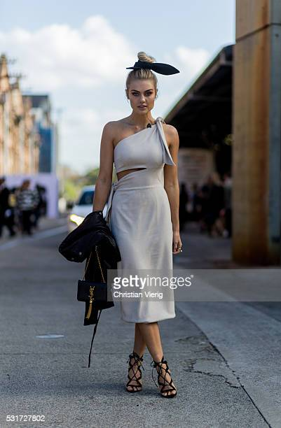 Elyse Knowles wearing a creme off shoulder dress from Misha Collection outside Misha Collection at MercedesBenz Fashion Week Resort 17 Collections at...