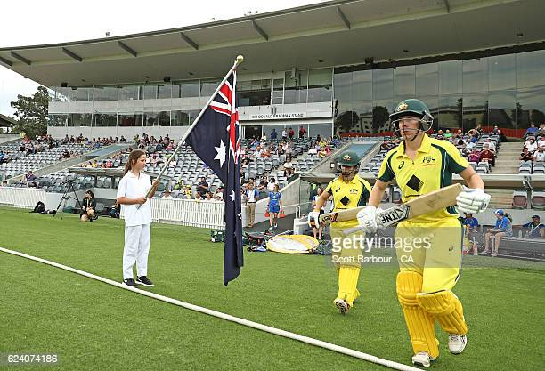 Elyse Villani and Nicole Bolton of the Australian Southern Stars walk out to bat during the women's one day international match between the...
