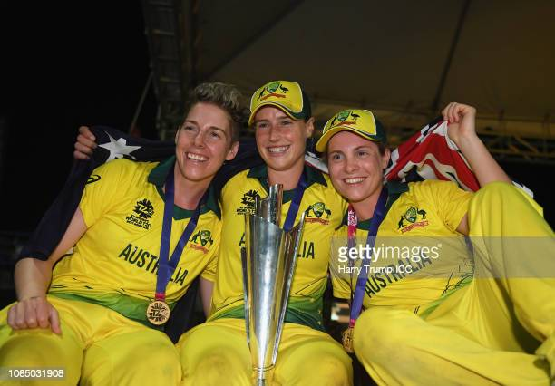 Elyse Villani Ellyse Perry and Sophie Molineux of Australia celebrate during the ICC Women's World T20 2018 Final between Australia and England at...