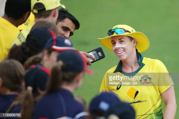 Elyse Villani of Australia signs autographs for fans during game three of the One Day International Series between Australia and New Zealand at...