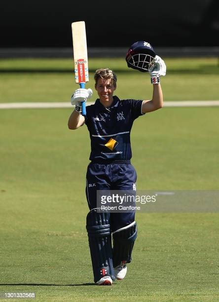 Elyse Villani of Victoria celebrates after scoring her century during the WNCL match between Victoria and New South Wales at Junction Oval on...