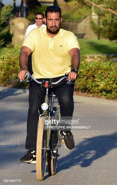 Elysee senior security officer Alexandre Benalla rides a bicycle in the streets of Le Touquet northern France as he accompanies the president on June...