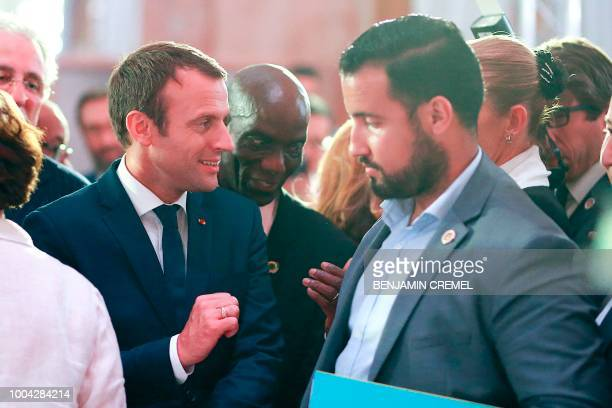 Elysee senior security officer Alexandre Benalla stands next to French President Emmanuel Macron as he arrives for a dinner organised by the French...
