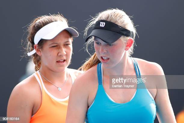 Elysia Bolton of the United States and Nicole Mossmer of the United States talk tactics in their doubles match against Alexa Noel of the United...