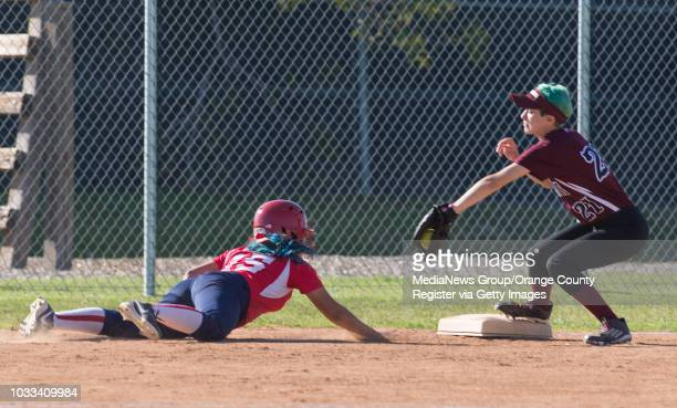 Elyssa Lopez of Bolsa Grande left dives safely back to third base as Taylor Glenn of Laguna Beach attempts the pick off ///ADDITIONAL INFORMATION...