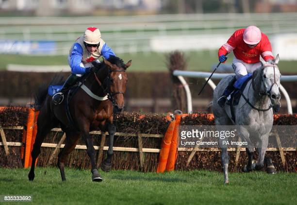 Elzahann ridden by Keith Mercer races clear of Pure Genius ridden by Tom O'Brien to go on to win the Coral Backing Poppyscotland Mares' Handicap...