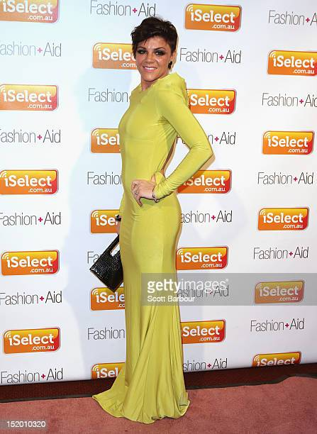 Em Rusciano arrives at iSelect Fashion Aid at Crown Palladium on September 15 2012 in Melbourne Australia