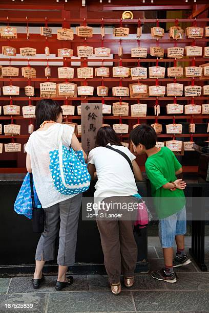 Ema are small wooden plaques on which Shinto worshippers write their prayers or wishes The votive tablets or ema are then left hanging up at the...