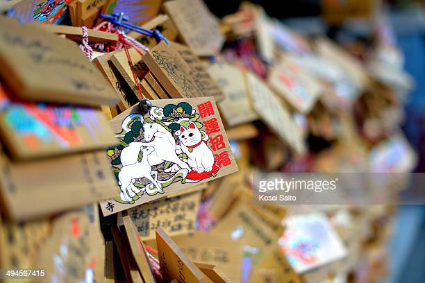 CONTENT] Ema are small wooden plaques on which Shinto worshippers write their prayers or wishes They bear various pictures often of animals or other...