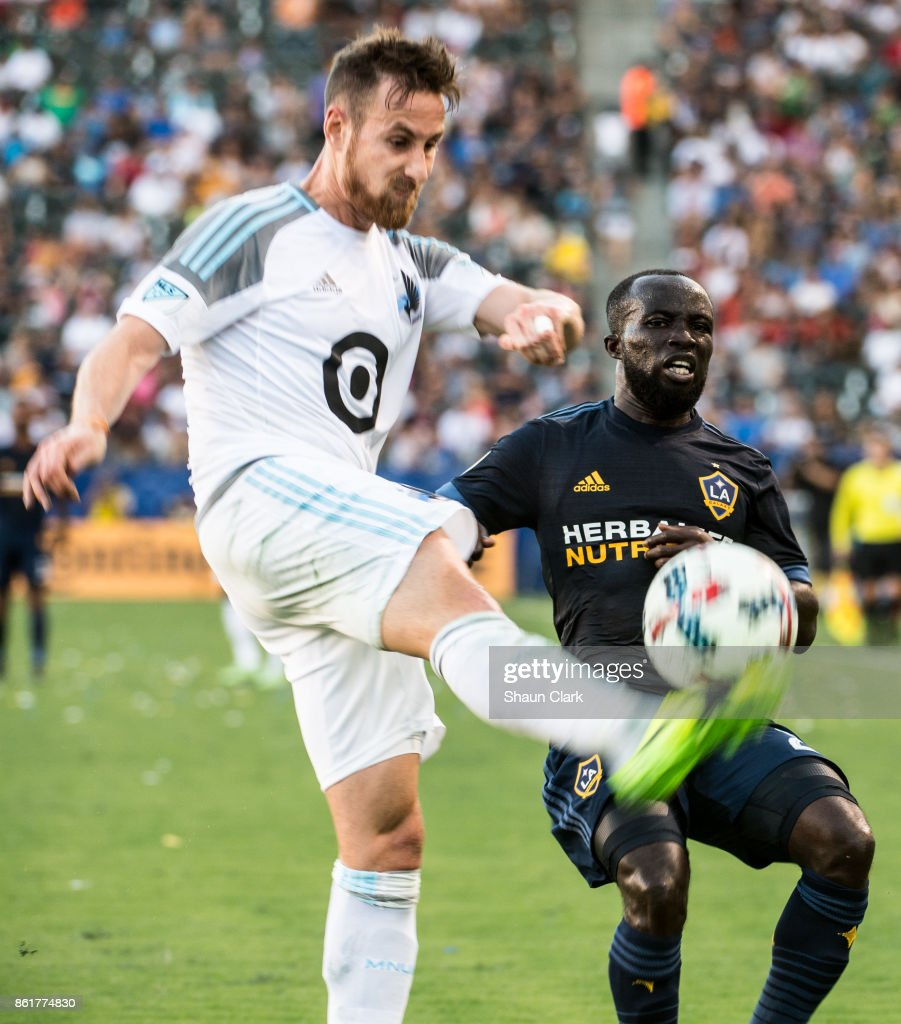Ema Boateng #24 of Los Angeles Galaxy battles Jerome Thiesson #3 of Minnesota United during the Los Angeles Galaxy's MLS match against Minnesota United at the StubHub Center on October 15, 2017 in Carson, California. Los Angeles Galaxy won the match 3-0