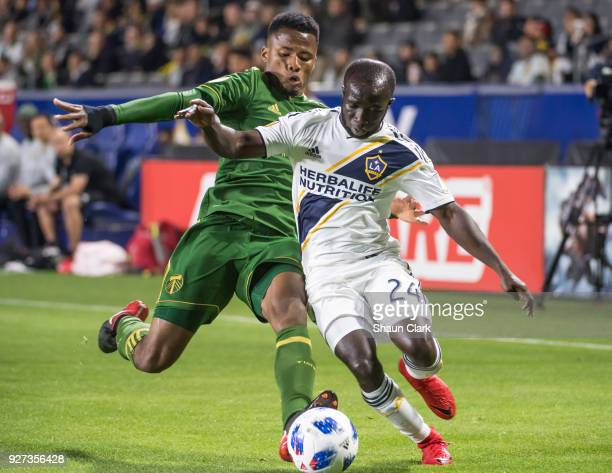 Ema Boateng of Los Angeles Galaxy beats Andy Polo of Portland Timbers during the Los Angeles Galaxy's MLS match against Portland Timbers at the...