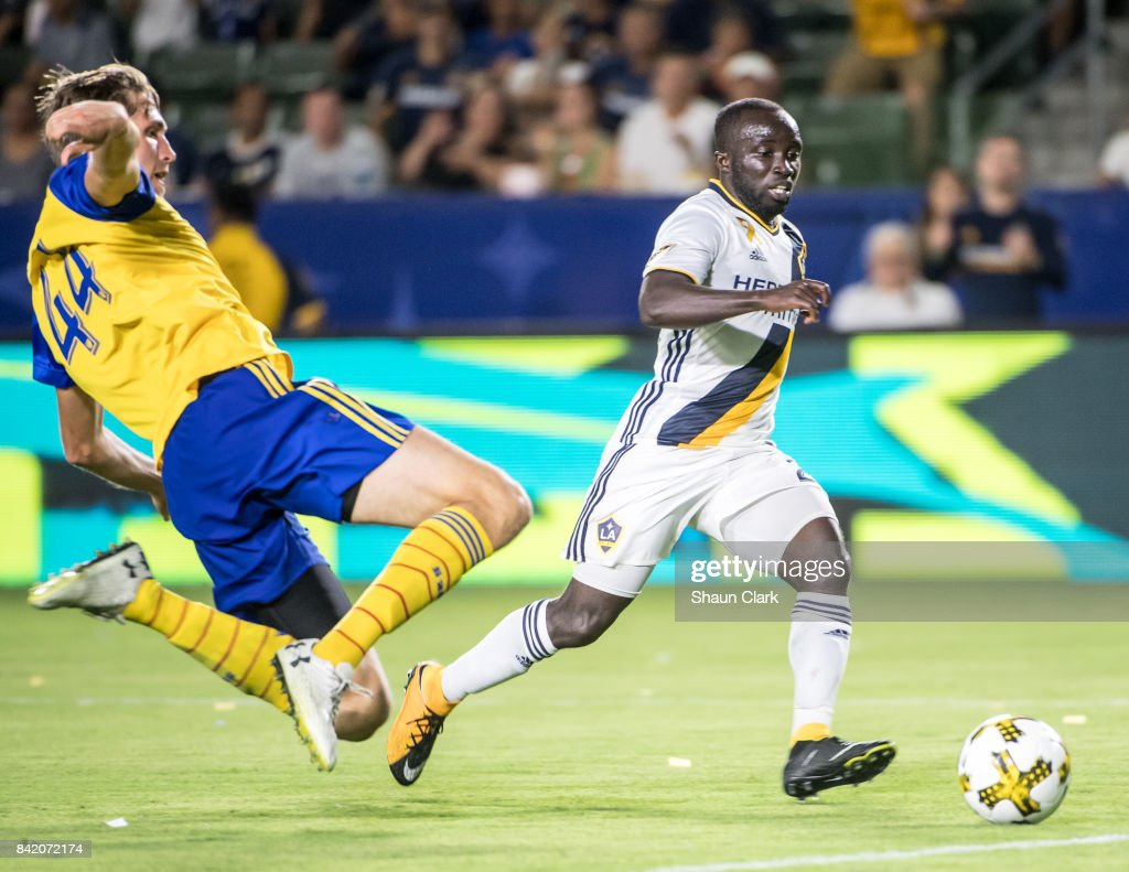 Ema Boateng #24 of Los Angeles Galaxy races toward goal as Axel Sjoberg #44 of Colorado Rapids defends during the Los Angeles Galaxy's MLS match against Colorado Rapids at the StubHub Center on September 2, 2017 in Carson, California. Los Angeles Galaxy won the match