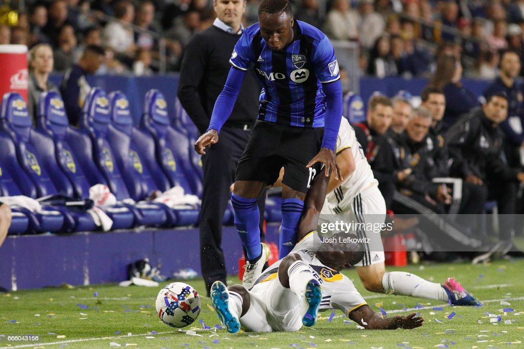 Ema Boateng #24 slides into play against Ballou Jean-Yves Tabla #13 of the Montreal Impact during the Los Angeles Galaxy's MLS match against the Montreal Impact at the StubHub Center on April 7, 2017 in Carson, California.
