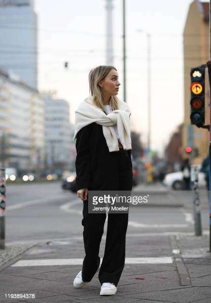 Ema Louise wearing otherstories pants and sweater Mango blazer on December 12 2019 in Berlin Germany