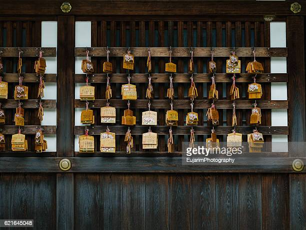 Ema(Japanese wooden plaque) on the wall of shrine