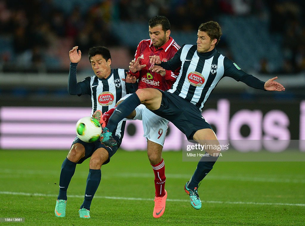 Emad Meteab of Al-Ahly is sandwiched between Ricardo Orsorio (L) and Hiram Mier of CF Monterrey during the FIFA Club World Cup 3rd Place Match between Al-Ahly SC and CF Monterrey at International Stadium Yokohama on December 16, 2012 in Yokohama, Japan.
