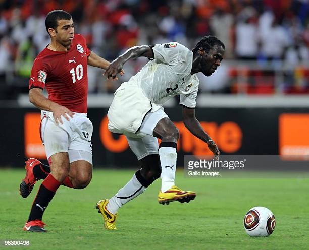 Emad Motaeb of Egypt and Hans Sarpei of Ghana during the Africa Cup of Nations final match between Ghana and Egypt from November 11 Stadium on...