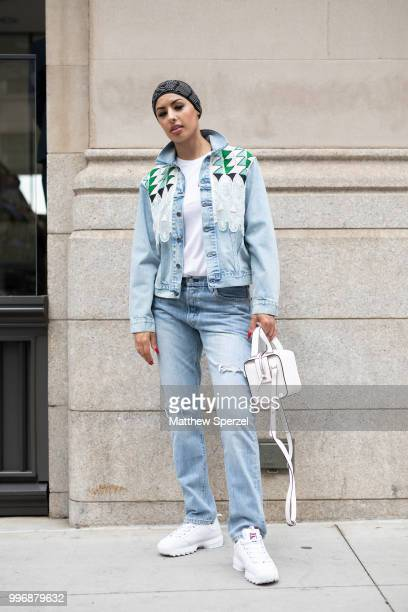 Eman B Fendi is seen on the street during Men's New York Fashion Week wearing Levi outfit Fila shoes French Connection bag on July 11 2018 in New...
