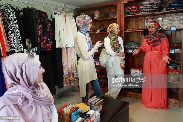Eman Elnachar Laila Saboune Zena Dakkak and Neha KhassoukDakkak shop at Sara Elmir's home clothing studio on December 4 2014 in Bankstown Australia...