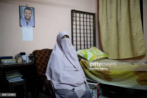 Eman Gomaa mother of Mosaab Elshamy a photojournalist who was killed during Rabaa dispersal on the 14th of August is seen in her son's room during an...