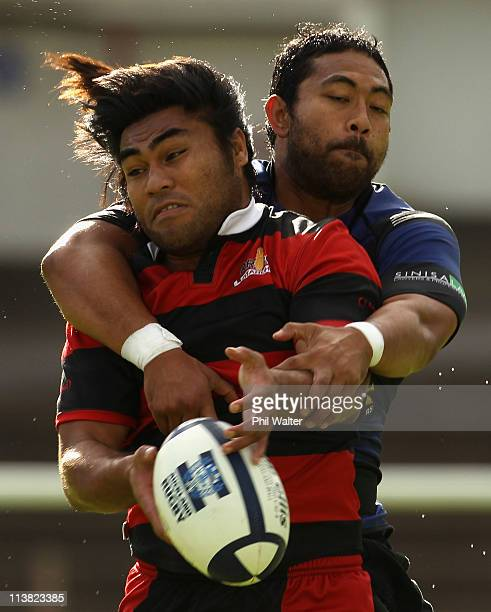 Emani Tuimauga of Otahuhu and Paula Kavienga of Ponsonby grasp at the ball during the Alan McEvoy Trophy game between Ponsonby and Otahuhu at Western...