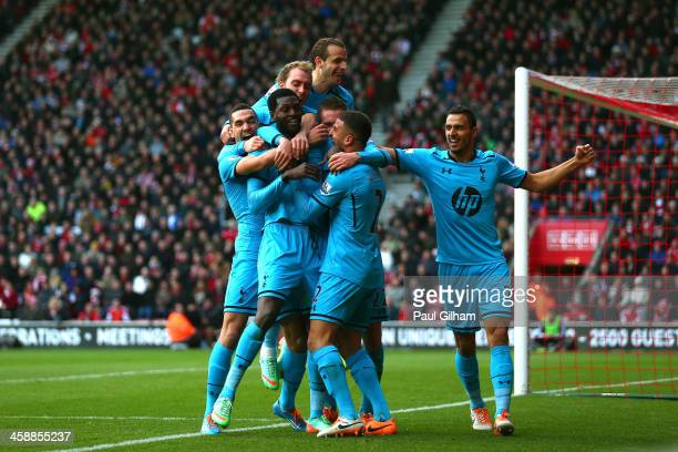 Emanuel Adebayor of Spurs celebrates with teammates after scoring his team's third goal during the Barclays Premier League match between Southampton...
