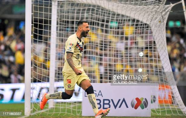 Emanuel Aguilera of America celebrates after scoring a goal during the Mexican Apertura tournament football match between Club America and...