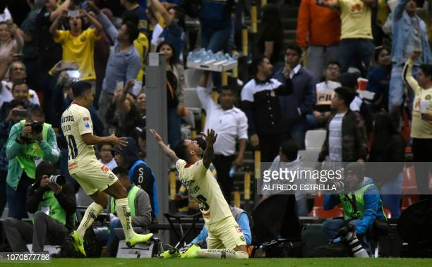 Emanuel Aguilera of America celebrates his goal against Pumas with his teammate Paul Aguilar during the second round of semifinals of the Mexican...