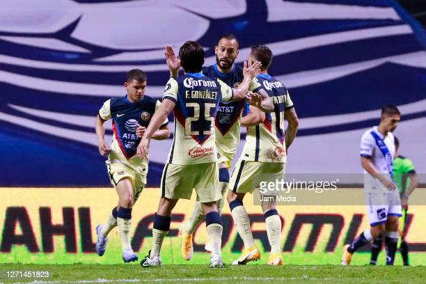 Emanuel Aguilera of America celebrates with teammates after scoring the first goal of his team during the 9th round match between Puebla and America...