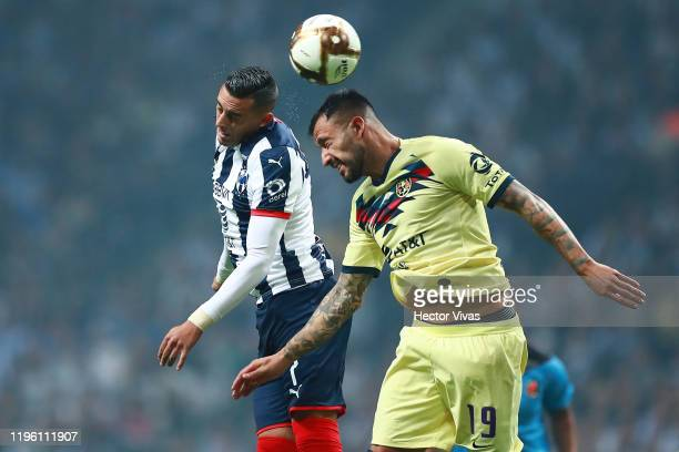 Emanuel Aguilera of America struggles for the ball against Rogelio Funes Mori of Monterrey during the Final first leg match between Monterrey and...