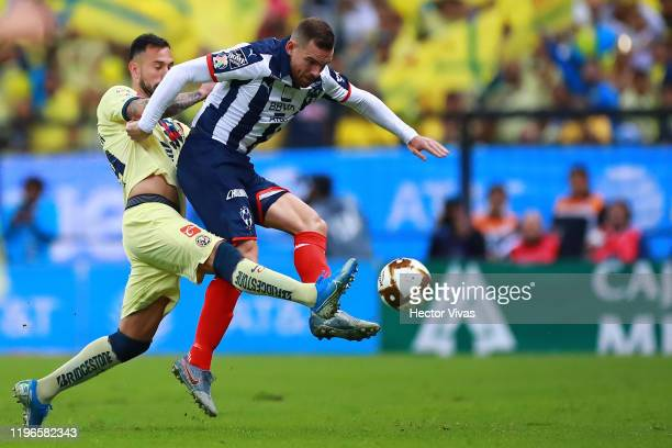 Emanuel Aguilera of America struggles for the ball against Vincent Janssen of Monterrey during the Final second leg match between America and...