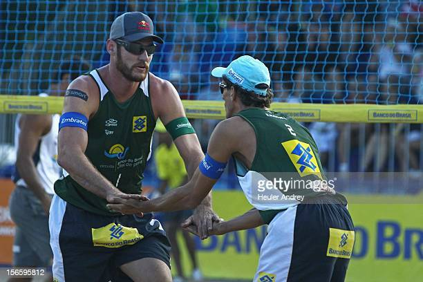 Emanuel and Alisson celebrate during a match for the 5th stage of the season 2012/2013 of Banco do Brasil Beach Volleyball Circuit on November 17...