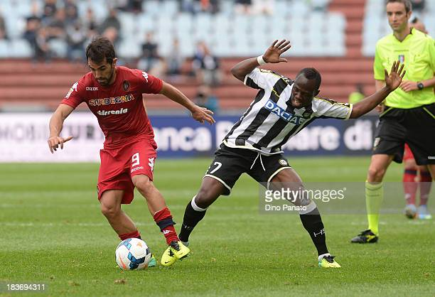 Emanuel Badu of Udinese competes with Marco Sau of Cagliari during the Serie A match between Udinese Calcio and Cagliari Calcio at Stadio Friuli on...
