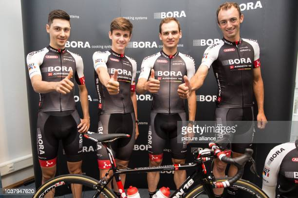 Emanuel Buchmann Patrick Konrad Paul Voss and Andreas Schillinger from cycle team BoraArgon 18 pose during their introductory press event for the...