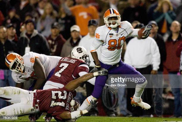 Emanuel Cook and teammate Addison Williams of the South Carolina Gamecocks work to bring down Aaron Kelly of the Clemson Tigers during the second...
