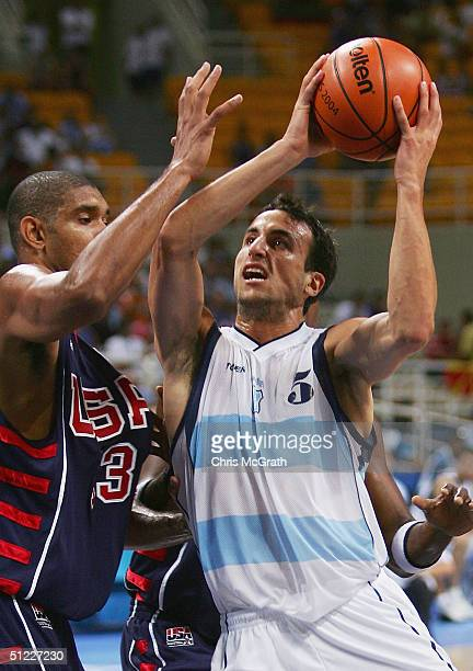 Emanuel David Ginobili of Argentina goes to the basket against Tim Duncan of United States in the first half of the men's basketball semifinal game...