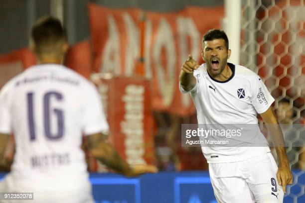 Emanuel Gigliotti of Independiente celebrates with teammate Fabricio Bustos after scoring the first goal of his team during the match between...