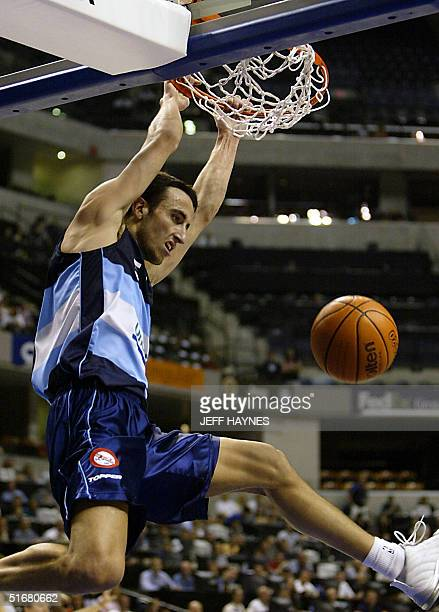 Emanuel Ginobili of Argentina dunks a shot 07 September, 2002 during the first half action against Germany in the semi-finals game of the 2002 Men's...