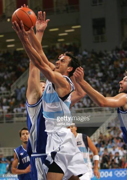 Emanuel Ginobili of Argentina shoots over the defense of Italy during the men's basketball gold medal contest game on August 28 2004 during the...
