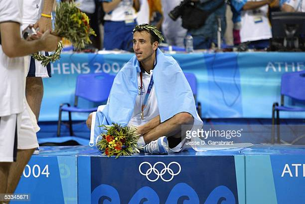 Emanuel Ginobili of Argentina sits on the podium after the Men's Medal ceremony after defeating Italy for the Men's Gold Medal on August 28 2004...